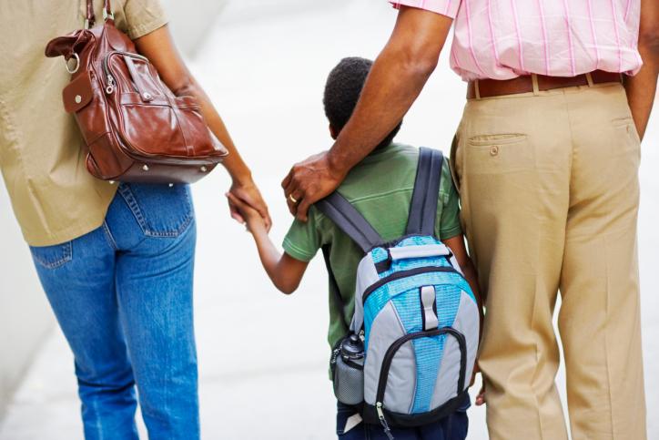 Parents Walking Son to School