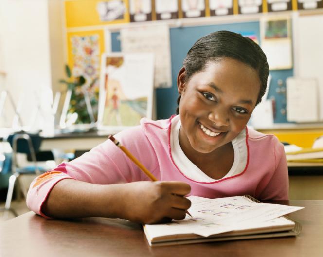girl in school writing