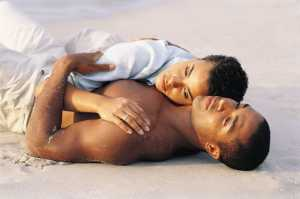 couple laying on beach serious