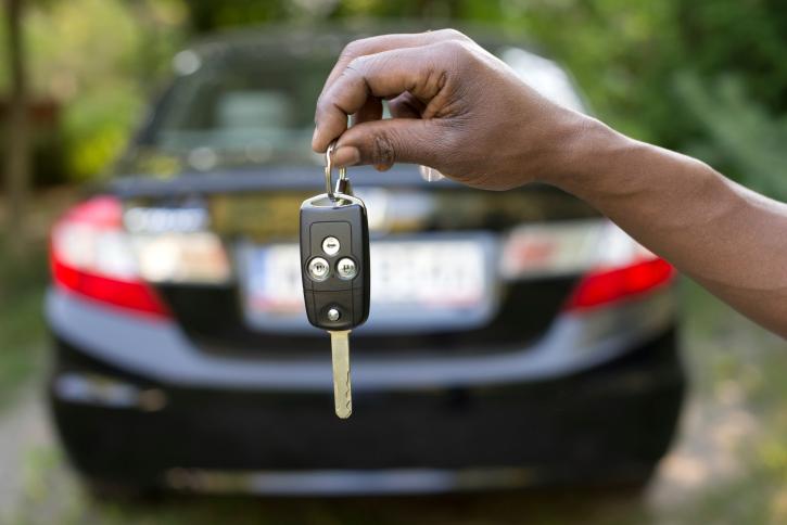 Man holding car keys