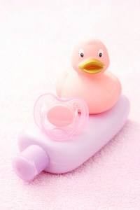 baby lotion, pacifier and plastic ducky
