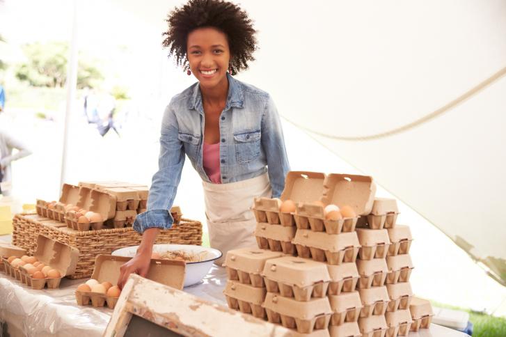 Woman Selling Fresh Eggs At Farmers Food Market