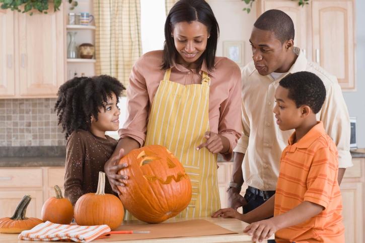 Family carving Halloween pumpkin