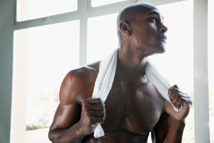 African American man shirtless after workout sweaty