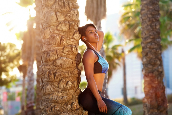African American Black woman in sport workout clothes