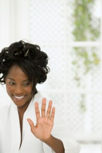 African American black Mature woman looking at her hand