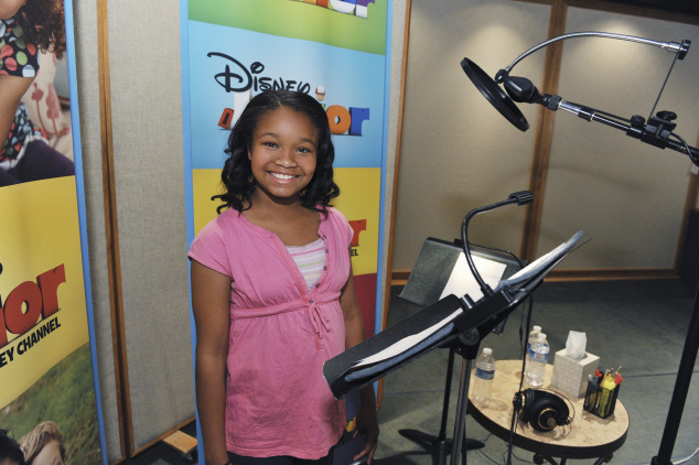 "DOC MCSTUFFINS - May 17, 2011 - Kiara Muhammad records the title role of Doc in Disney Junior's ""Doc McStuffins,"" an animated series that models good health, hygiene, compassion and nurturing for kids age 2-7. The series premieres FRIDAY, MARCH 23 on the popular Disney Junior block on Disney Channel (10:00-11:00 a.m., ET/PT) and the new 24-hour Disney Junior channel (4:00-5:00 p.m., ET/PT). (DISNEY JUNIOR/TODD WAWRYCHUK) KIARA MUHAMMAD"