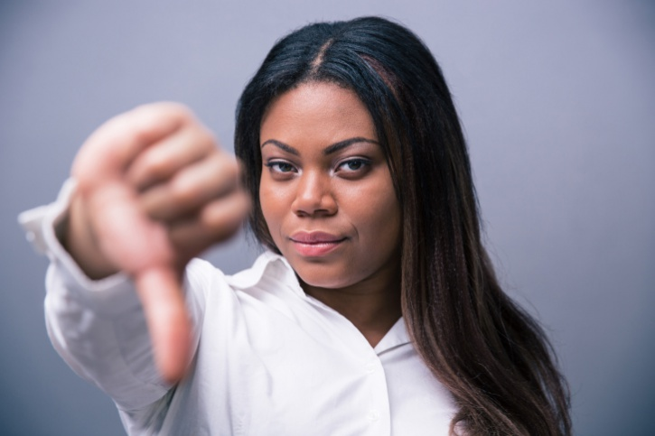 African American woman disgusted thumbs down sign