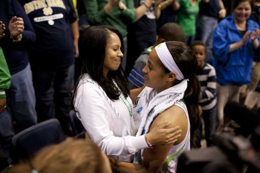 South Bend Tribune/JAMES BROSHER Notre Dame guard Skylar Diggins, right, shares a hug with her mother, Renee Scott, after a 93-63 win against Kansas in the women's NCAA college basketball tournament on Sunday, March 31, 2013, in Norfolk, Va. Diggins scored 27 points in the win and became Notre Dame's all-time scoring leader.