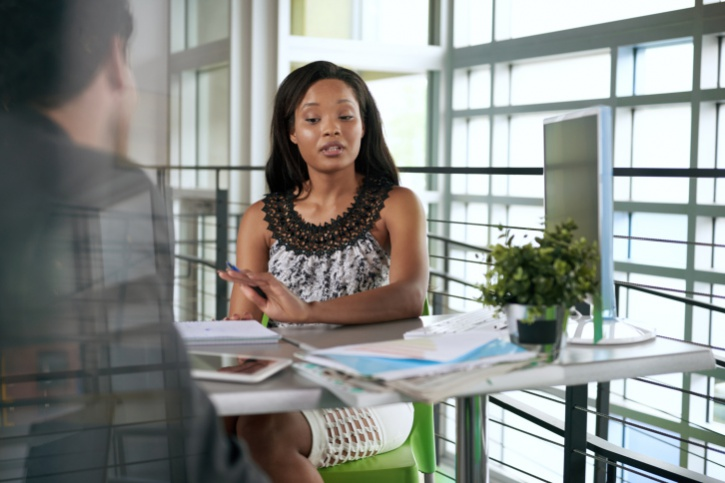African American woman in office talking