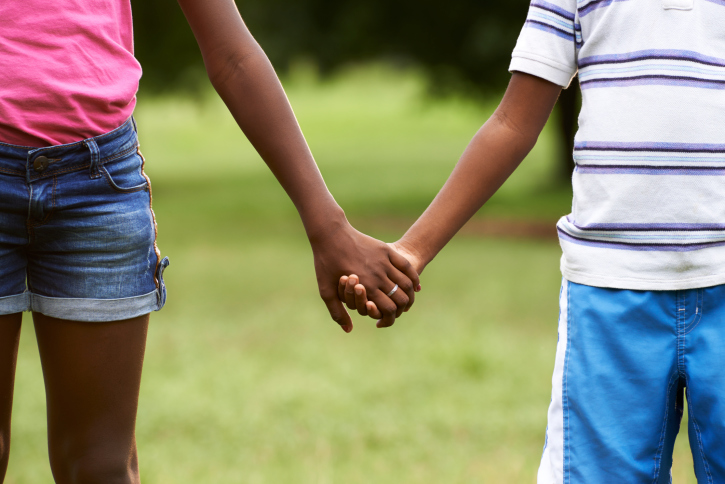 African American boy and girl holding hands