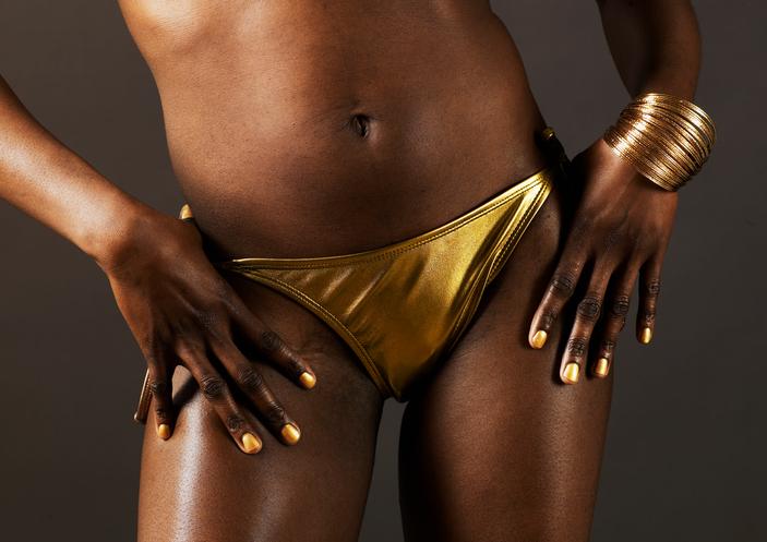 Close-Up of Young Woman in Golden Bikini Bottom