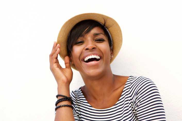 Happy African American woman wearing hat 819e231e305