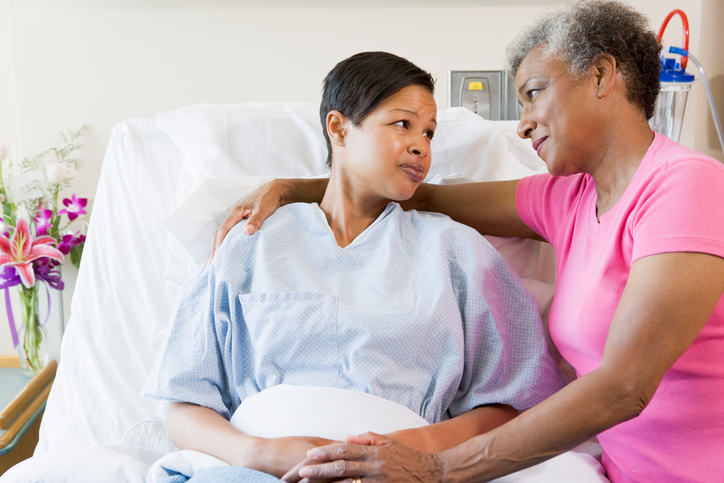 African american mother and daughter in hospital looking at each other