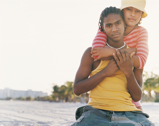 African American Teenage couple on beach