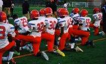 Watkins Mill High School Football team takes a knee. Source: Twitter user @Peete_era20