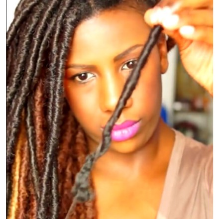 Donedo removes her faux locs by pulling and unraveling.