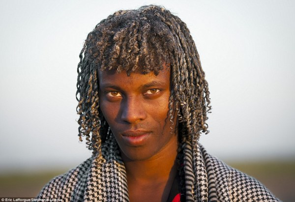 An Ethiopian man with ghee in his hair