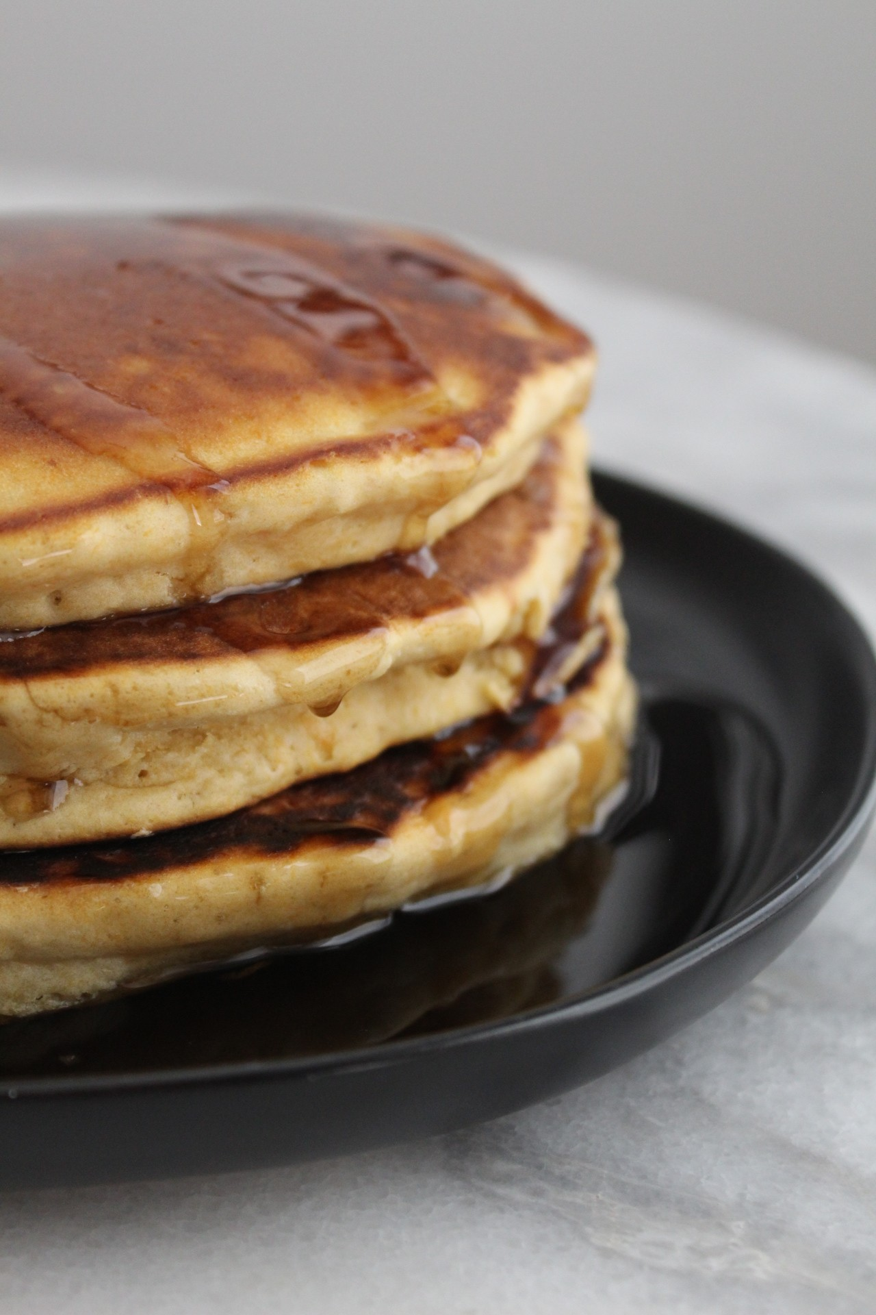 Fluffy Pancakes on Black Plate