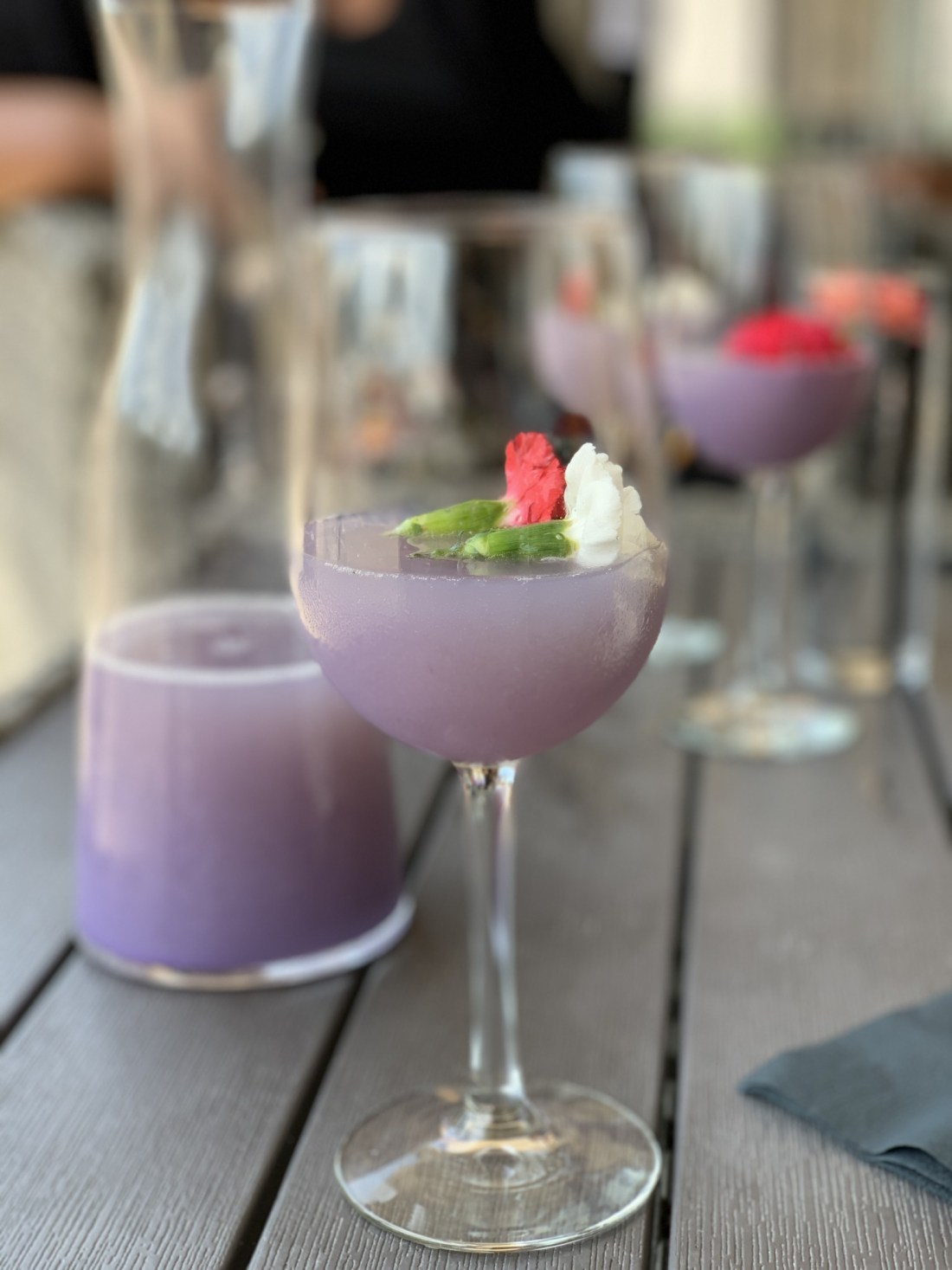 Purple mimosa and glass with carafe