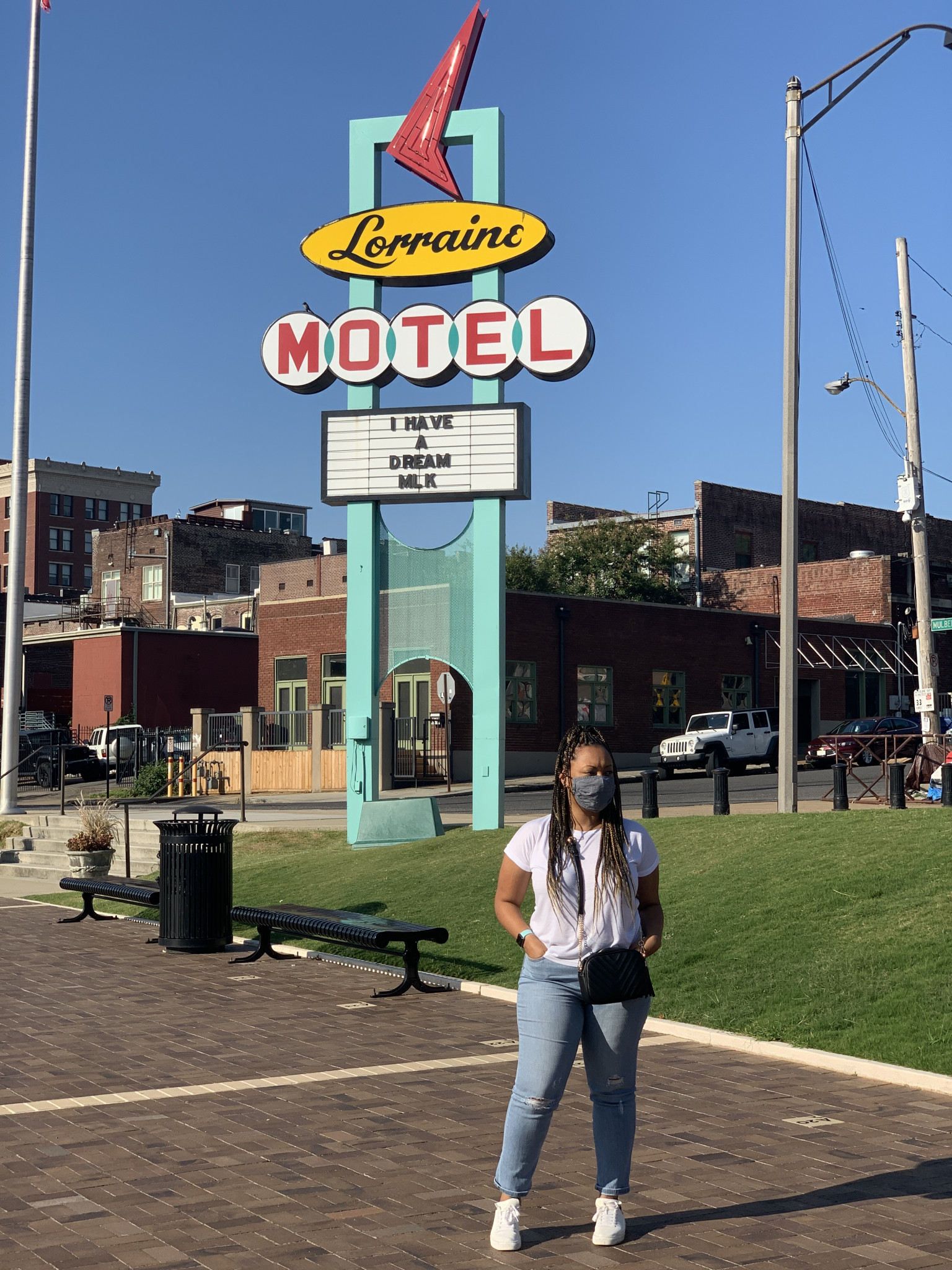 Woman standing in front of Lorraine Motel Sign