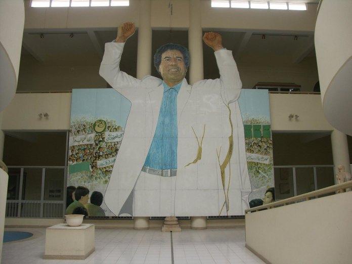 statue of gaddafi raising fists