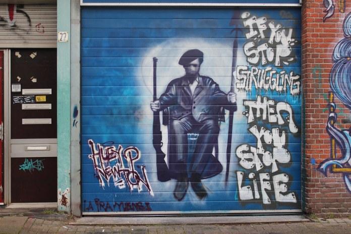 Graffiti artwork of Huey Newton. The words say