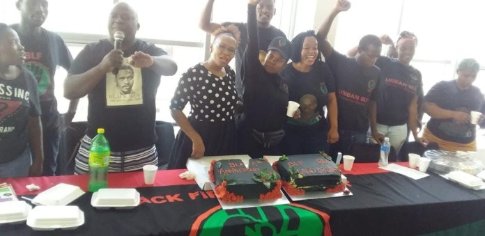 Members of BLF tabling with their fists up