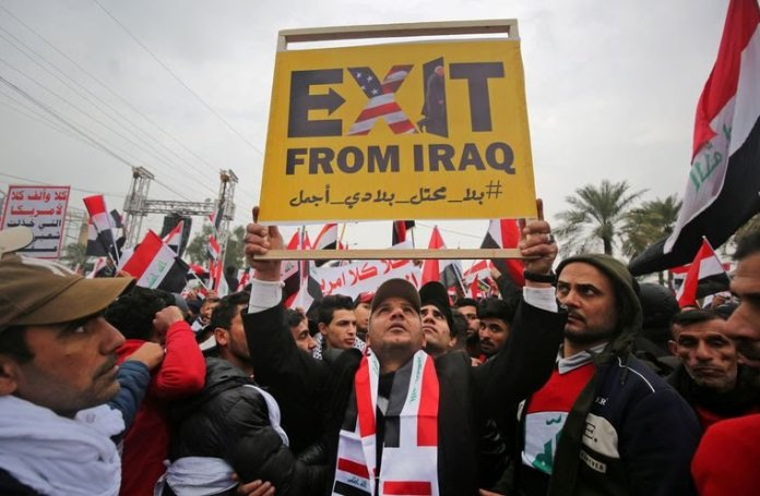 Protester holding (amerikkka)Exit from Iraq