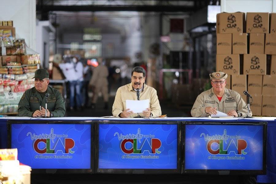 (President Nicolas Maduro held a televised meeting alongside Defense Minister Vladimir Padrino Lopez (L) and Food Minister and Militia Commander Carlos Leal Telleria (Presidential Press)