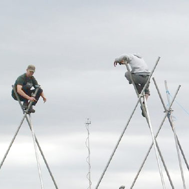Tripods at the climate camp, Blackheath by flickr user Bagelmouse