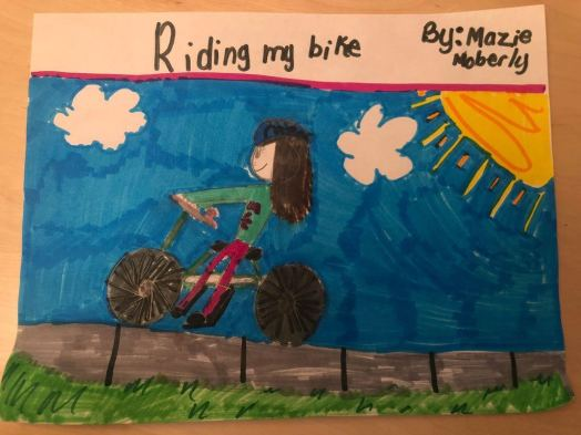 """Riding my bike."" - Mazie, Age 10"