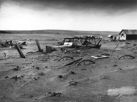 Buried machinery in barn lot in Dallas, South Dakota, United States during the Dust Bowl, an agricultural, ecological, and economic disaster in the Great Plains region of North America in 1936