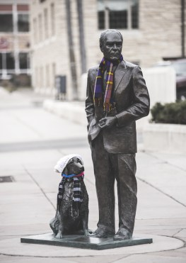 President statue with scarf and dog