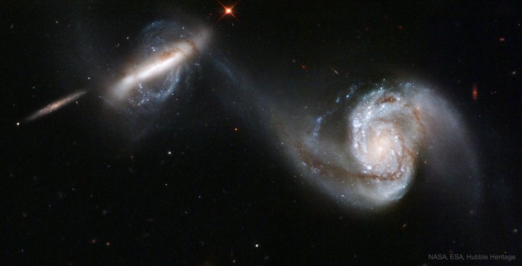 Interacting galaxies Arp 87 observed by the Hubble Space Telescope.