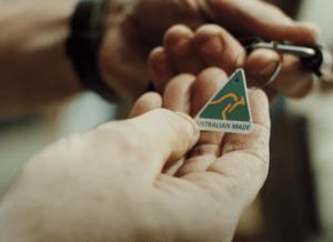 hands holding australian made logo