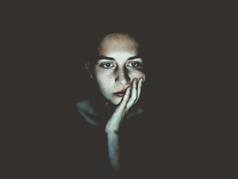 fatigued woman staring at screen
