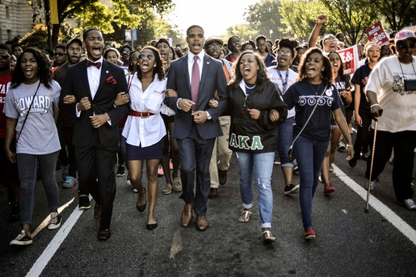 "Students of Howard University march from campus to the Lincoln Memorial to participate in the Realize the Dream Rally for the 50th anniversary of the March in Washington August 24, 2013. Thousands of marchers were expected in Washington, D.C. on Saturday to commemorate the 50th anniversary of the Rev. Martin Luther King Jr.'s ""I have a dream"" speech and to urge action on jobs, voting rights and gun violence. REUTERS/James Lawler Duggan (UNITED STATES - Tags: POLITICS ANNIVERSARY CIVIL UNREST TPX IMAGES OF THE DAY) - RTX12V40"