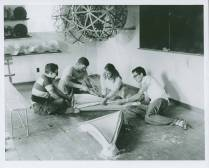 """Buckminster Fuller's Architecture class, 1949 Summer Institute, Black Mountain College. Note on the back of the photo states: """"Architecture, construction of molds for precast forms for domes."""" Left to right: unidentified student, Eugene Godfrey, Mary Jo Slick, unidentified student. Courtesy North Carolina Museum of Art. Western Regional Archives."""