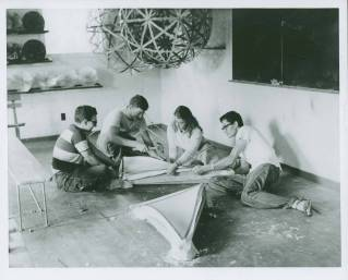 "Buckminster Fuller's Architecture class, 1949 Summer Institute, Black Mountain College. Note on the back of the photo states: ""Architecture, construction of molds for precast forms for domes."" Left to right: unidentified student, Eugene Godfrey, Mary Jo Slick, unidentified student. Courtesy North Carolina Museum of Art. Western Regional Archives."
