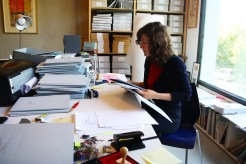 """Ofri Lapid working on """"Performing the Black Mountain Archive"""" at Arnold Dreyblatt's studio in Berlin."""