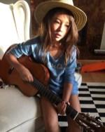 ella gross plays guitar