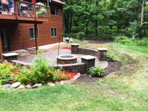 paver patio with custom freestanding sitting walls and fire pit