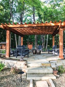 landscape with pergola and natural stone patio