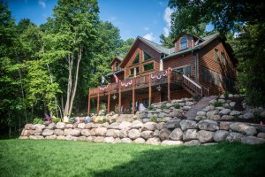 Boulder retaining walls with steps and a paver patio, plantings & sod