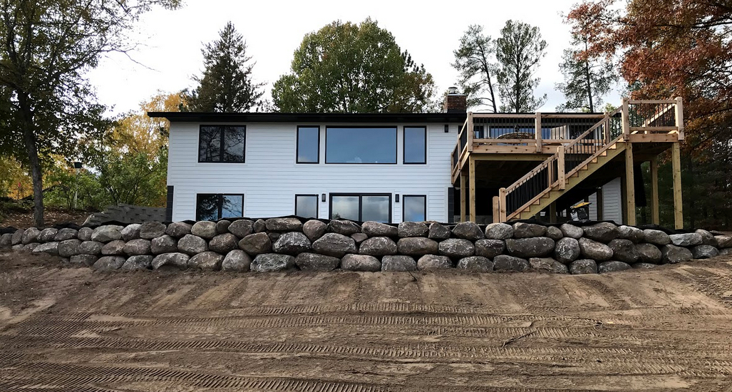Boulder wall constructed at a lakefront cabin