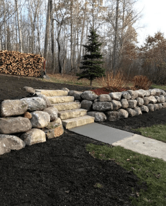 Boulder walls and custom stone stairs