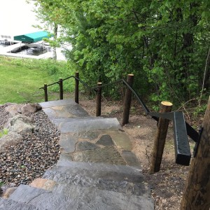 custom steps with rails built into landscaping on lake front home Brainerd Lakes area