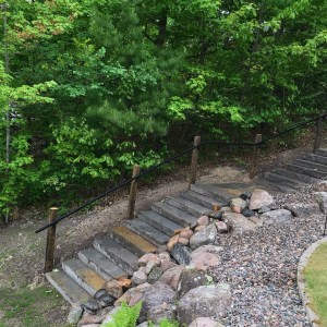 custom stone steps built into landscaping in Brainerd Lakes Area
