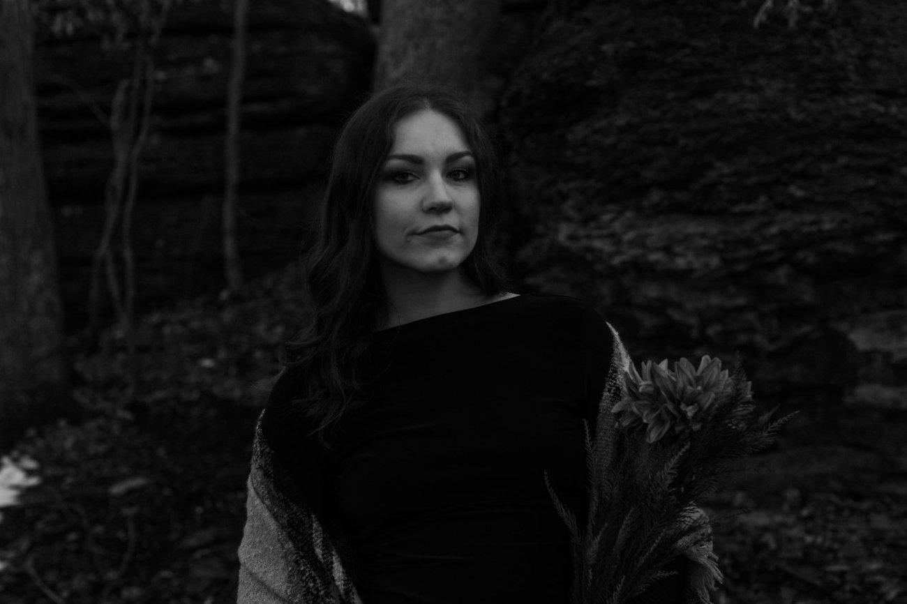 Black and white portrait of girl not smiling in black dress